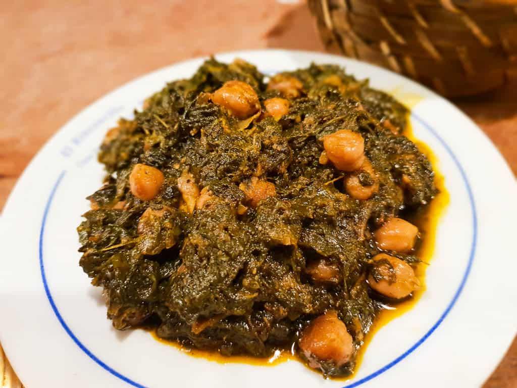 Eating spinach and garbanzo beans at Sevilla bars