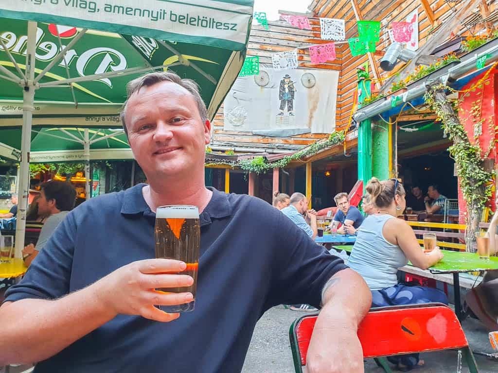 drinking at Ellátó Kert Budapest ruin pub