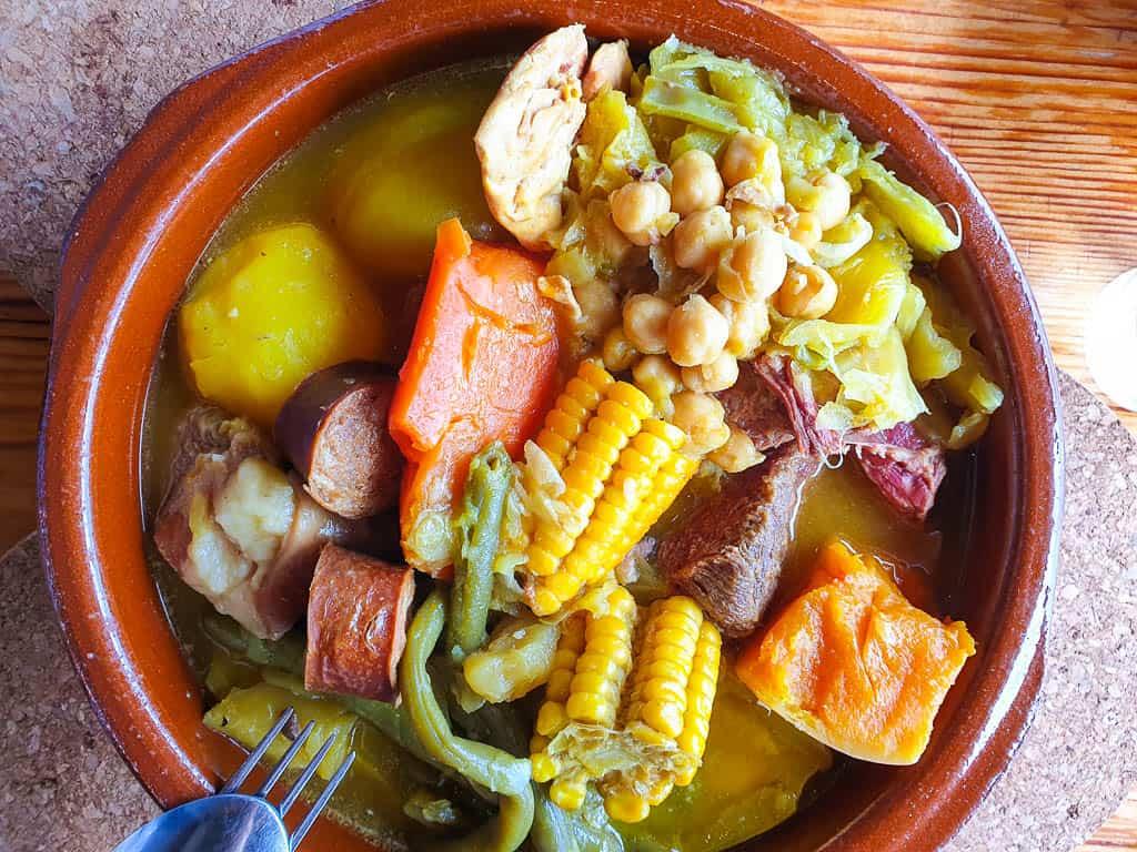 eating puchero in Tenerife