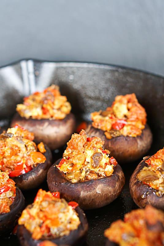 chorizo stuffed mushrooms in a cast iron skillet