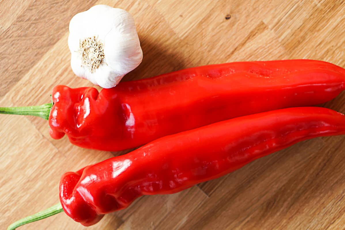 Cooking with red Spanish peppers and garlic